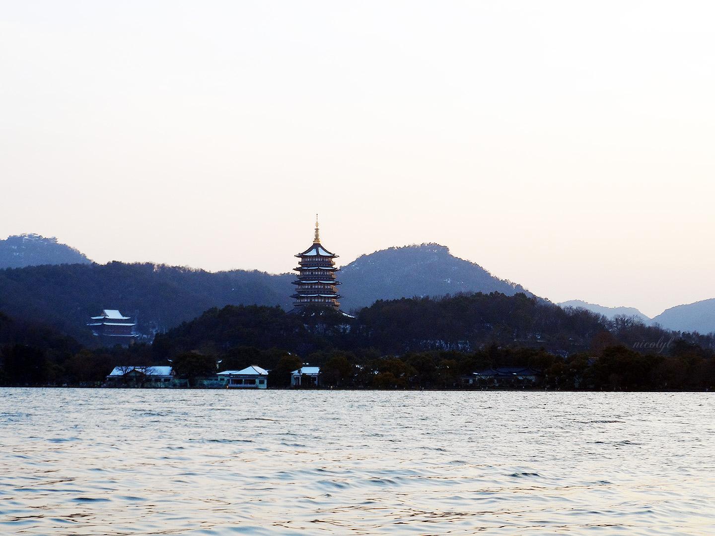 hangzhou west lake pagoda sunset