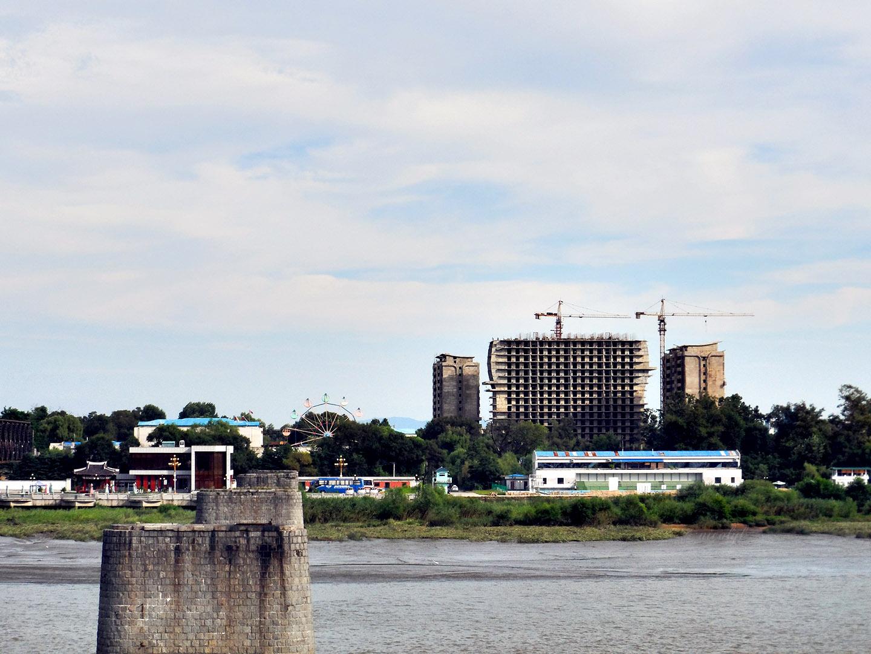 Sinuiju north korea across the yalu river, broken bridge dandong china