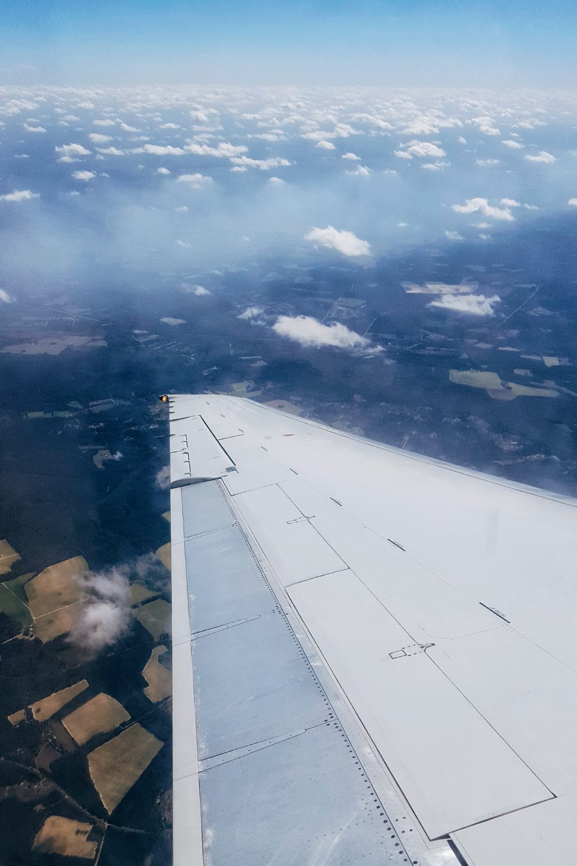 travel sky land clouds aeroplane wings